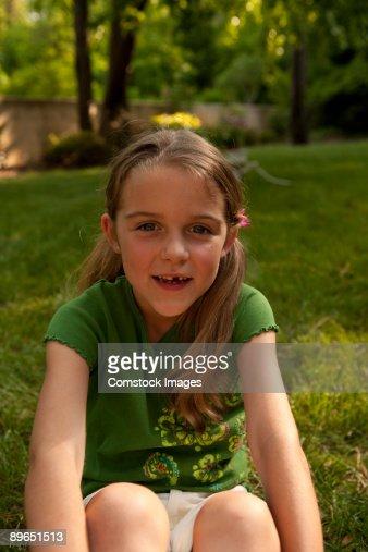 girls sitting in grass : Stock Photo