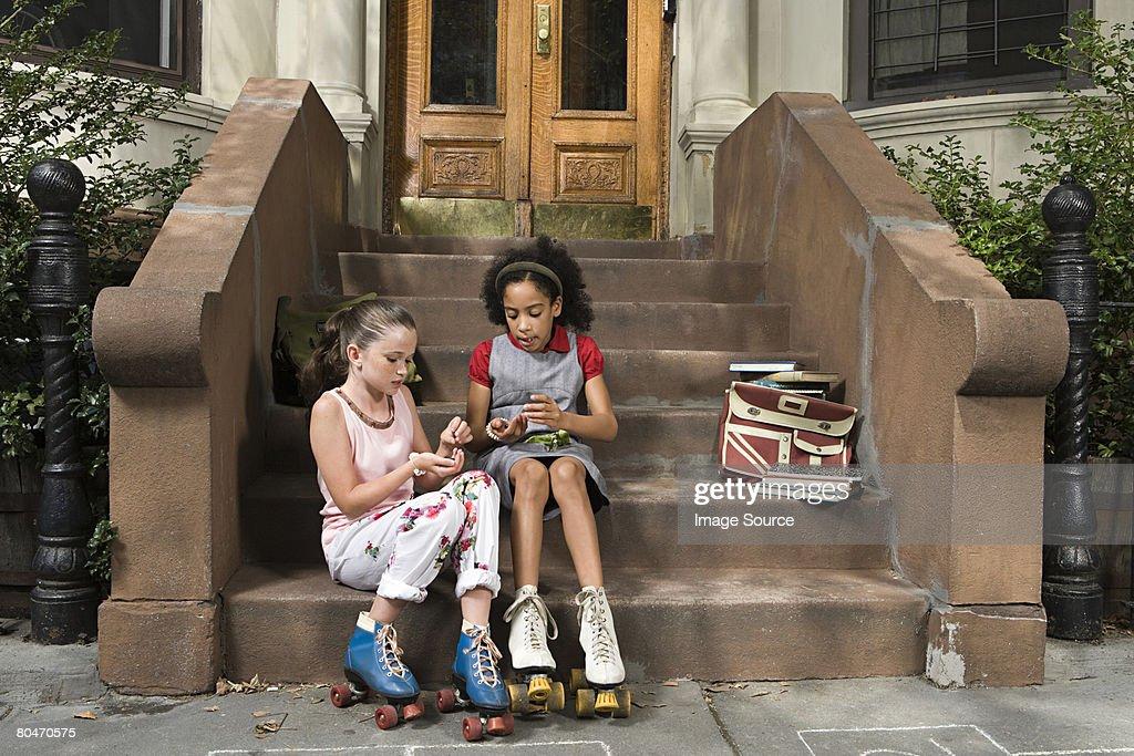 Girls sitting on steps