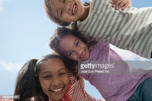 Girls smiling together outdoors : Stock Photo