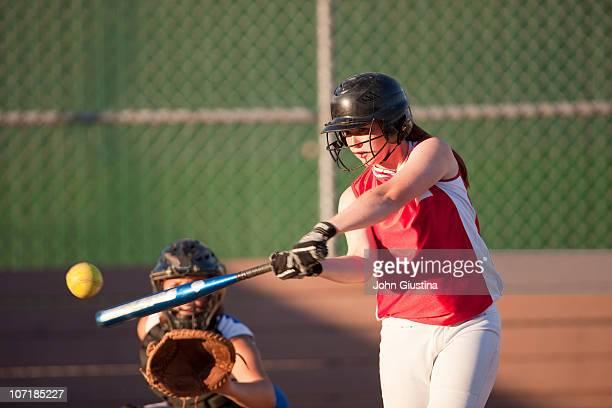 Girl's softball player batting.