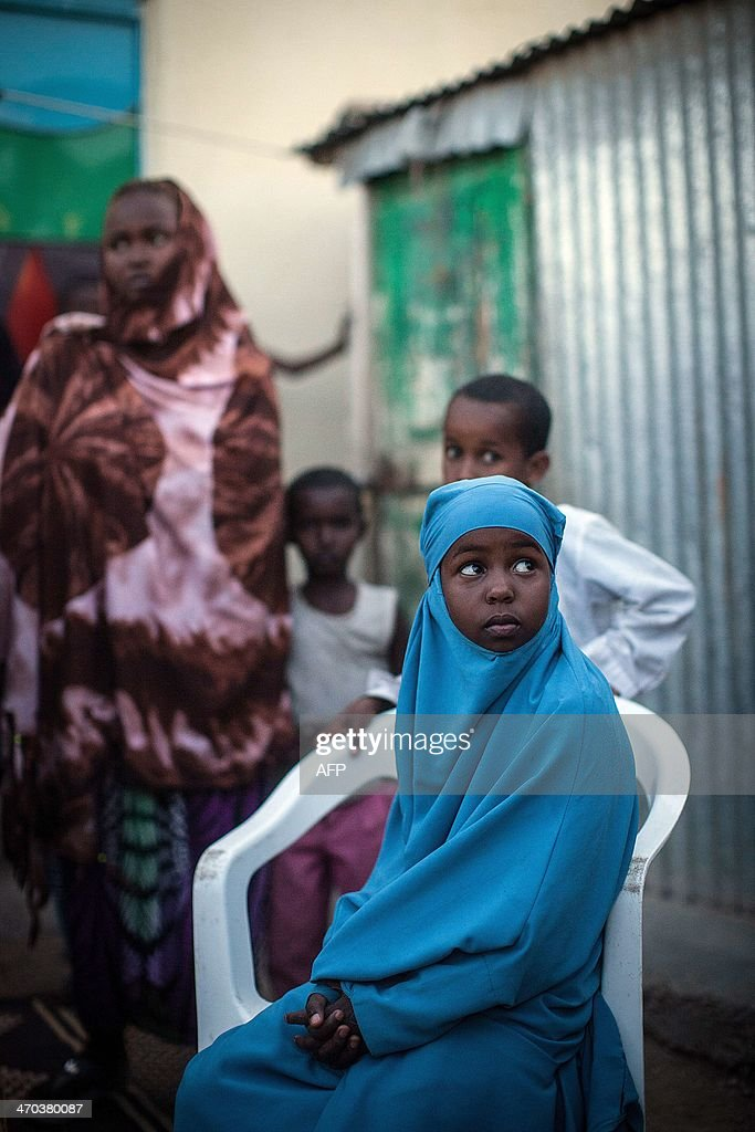 A girls speaks as she takes part with other young women and men in a community discussion on female genital mutilation in Hargeysa on February 19...