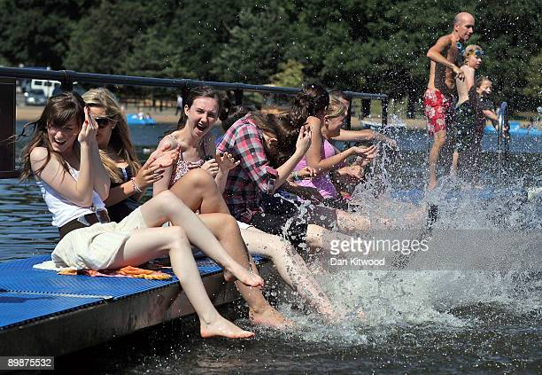Girls splash their feet in the Serpentine Lido on August 19 2009 in London England The Met office predicted one of the hottest days of the year so...
