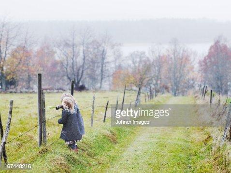 Girls standing at autumn field : Stock Photo