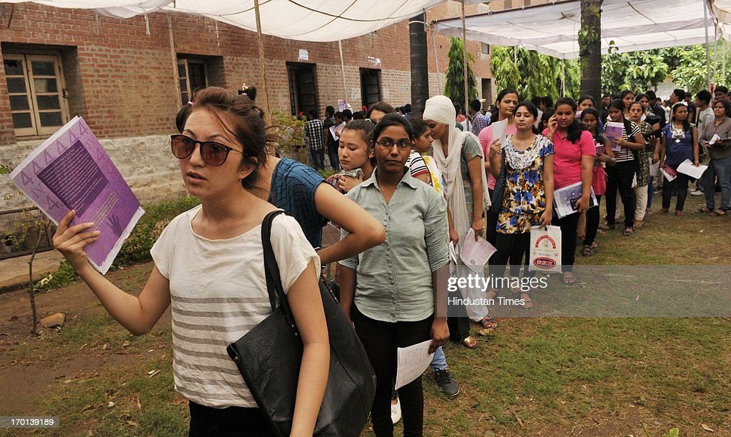 Girls standing in queue to submit their forms for admission in four-year undergraduate programme at North Campus of Delhi University on June 7, 2013 in New Delhi, India.