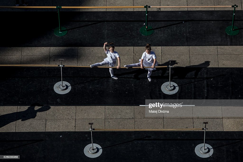 Girls stretch after an outdoor ballet class at the International Dance Day in front of the National Theatre on April 29, 2015 in Prague, Czech Republic. International Dance Day, which was introduced in 1982, is celebrated around the world on April 29.