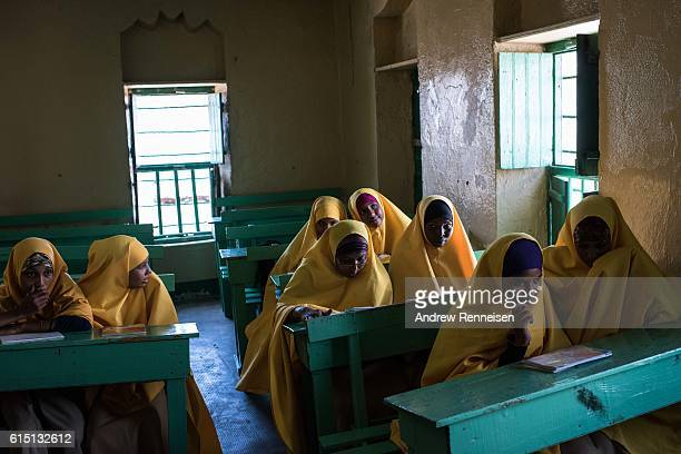 Girls study inside the Nur Islamic School on October 11 2016 in Barawe Somalia The city of Barawe was a stronghold for the AlShabaab militant group...