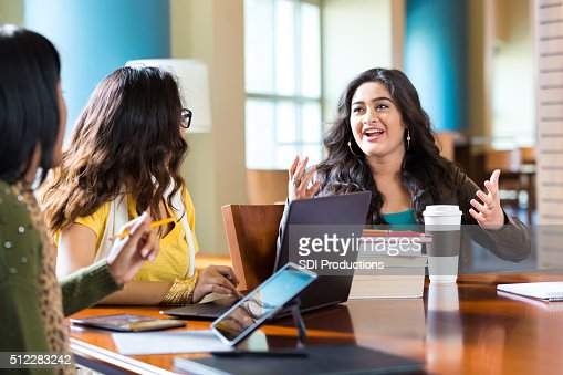 Girls studying for high school or college exam in library