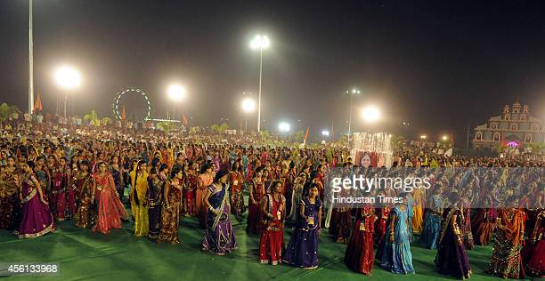 Girls take part in Garba dance on the first day of Navratri festival near Madan Mahal garden on September 25 2014 in Indore India Hindu festival of...