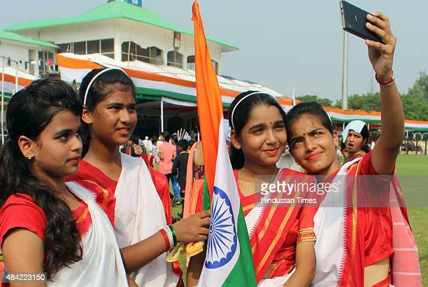 Girls take selfie after their performance on the occasion of Independence Day at Tau Devi Lal stadium on August 15 2015 in Gurgaon India Around 40000...