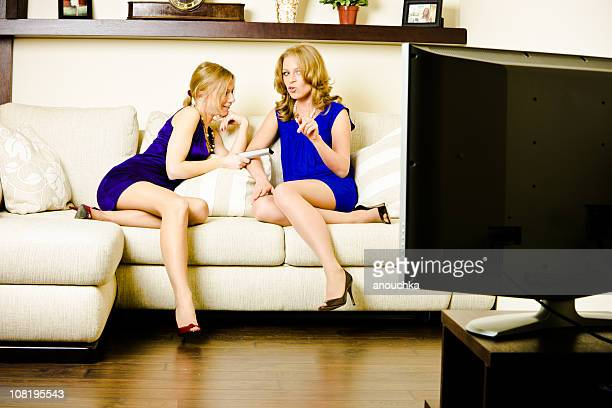 Girls talking and  watching TV at home