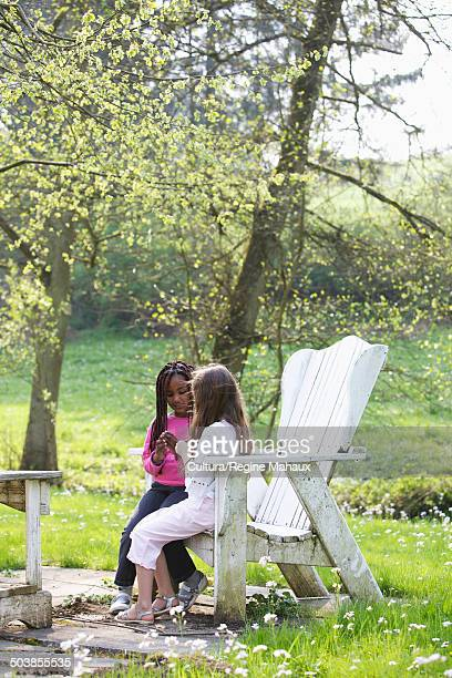 girls talking in a chair on a garden