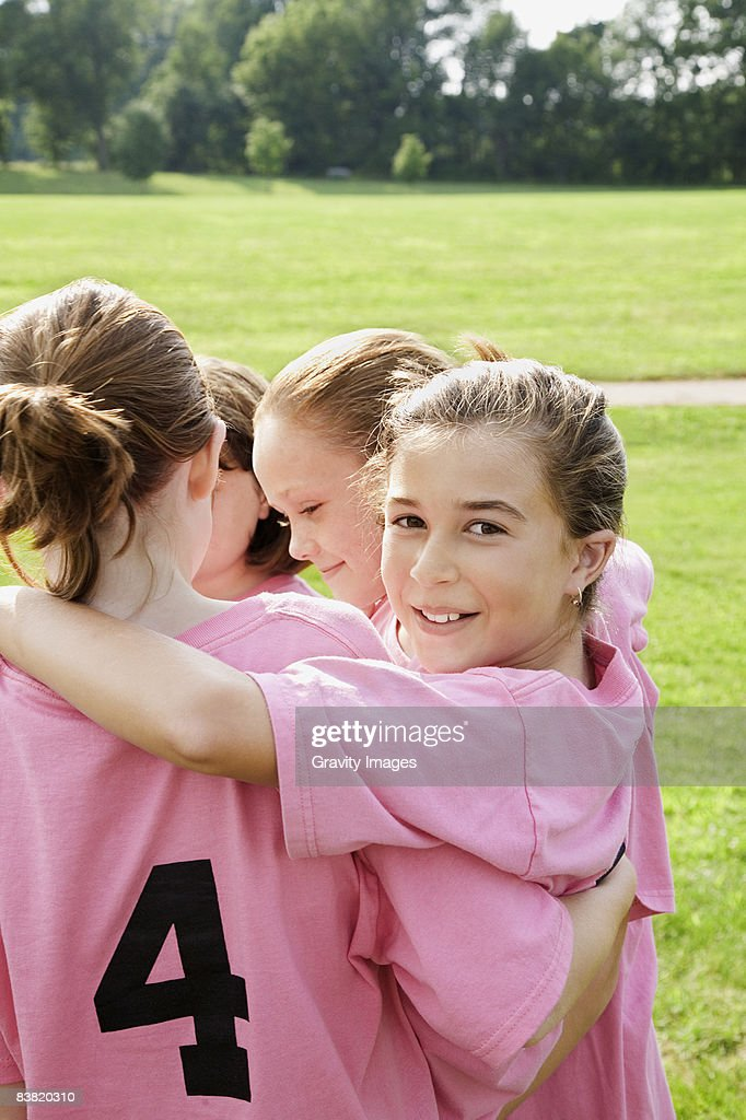 Girl's Team with Arms Around One Another : Stock Photo