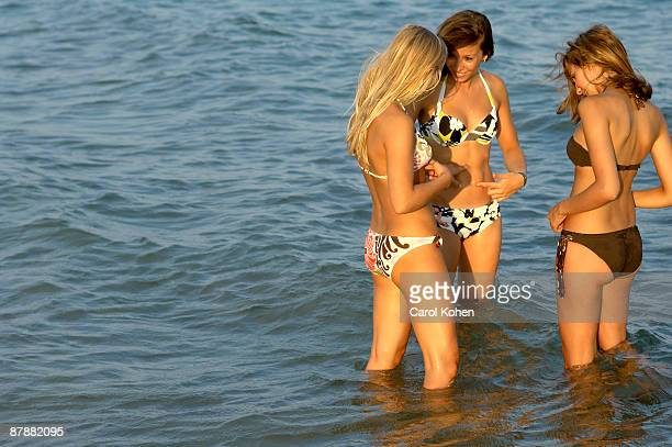 Girls teenagers playing in the sea