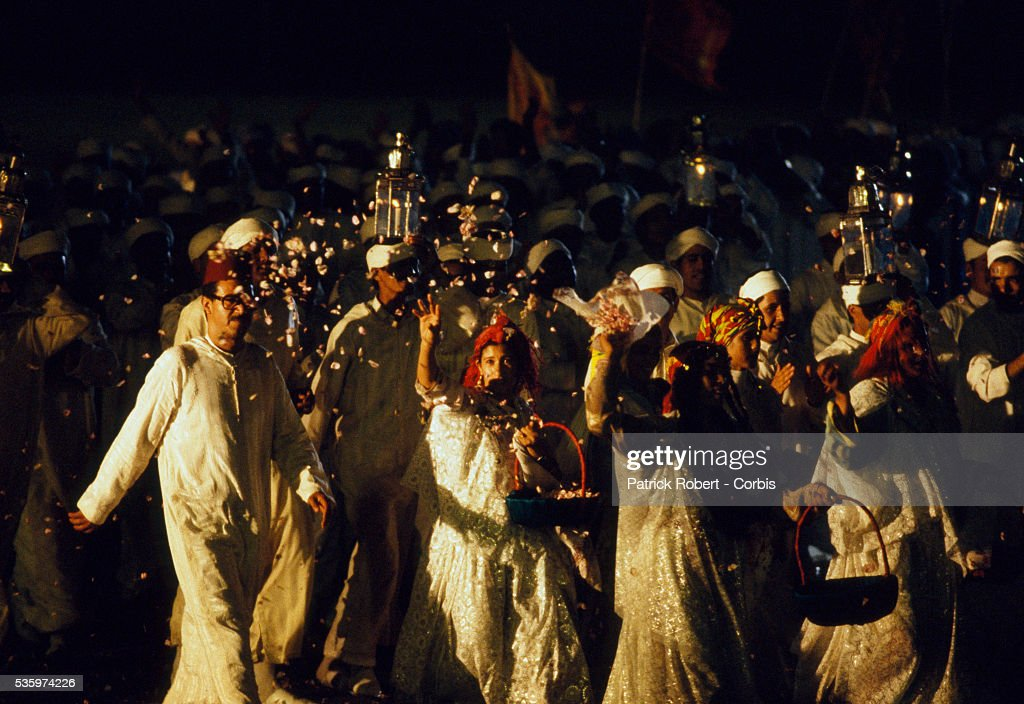 Girls throw flower petals during the wedding procession for Princess Lalla Asmaa, daughter of Hassan II, King of Morocco.
