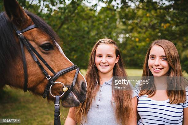 Girls together with their horse