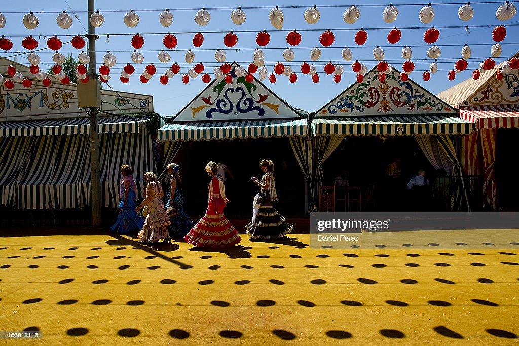 Girls traditionally dress as 'sevillanas' at the Feria de Abril (April's Fair) on April 17, 2013 in Seville, Spain.