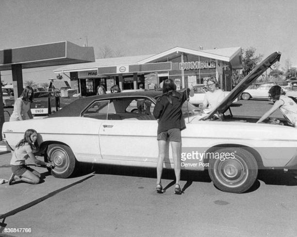 Girls Turn Service Station Attendants To Raise Money Members of Bethel 15 Job's Daughters drill team service a car at Danny's Village Enco Station S...