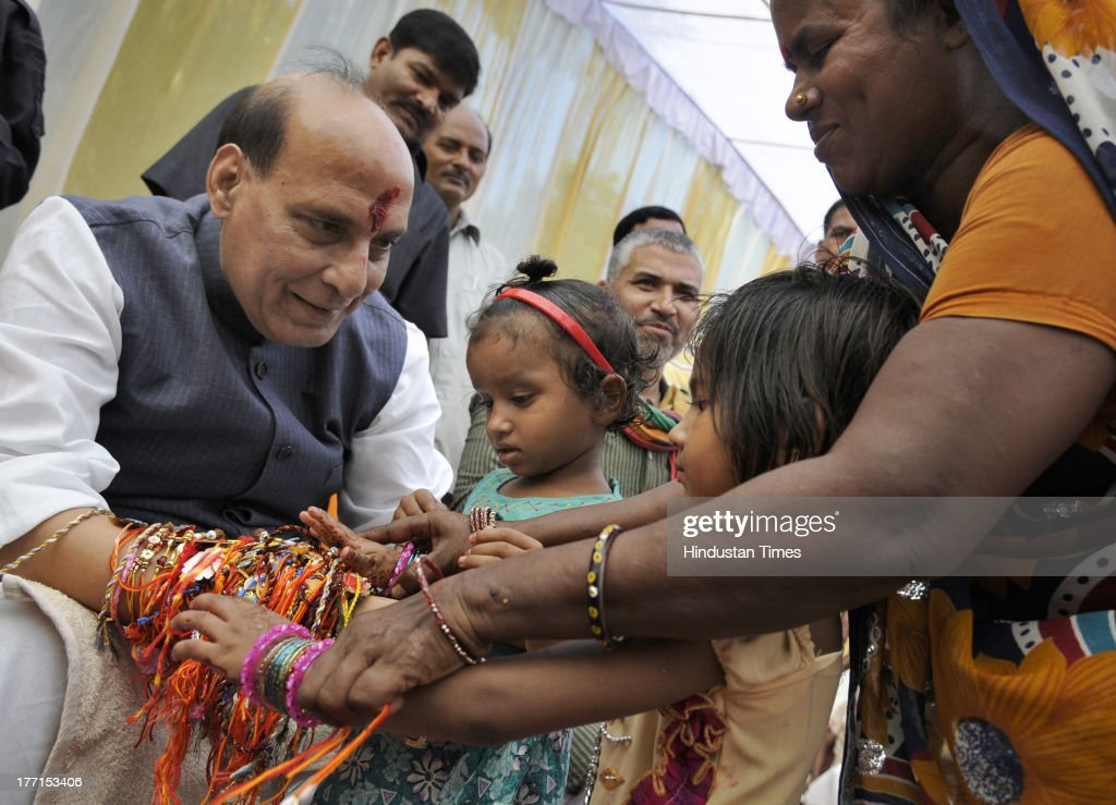 Girls tying Rakhi on the wrist of BJP President Rajnath Singh on the occasion of Rakhi festival at his house on August 21, 2013 in New Delhi, India. Raksha Bandhan, the festival of love between brothers and sisters, is being celebrated across the country today with full enthusiasm.