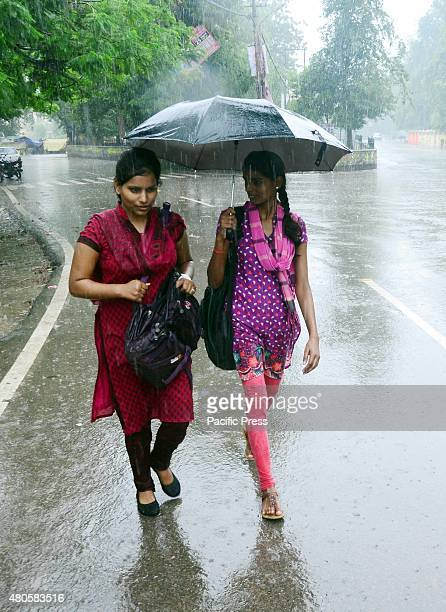 Girls use an umbrella during the rain The term monsoon is used to refer to the rainy season that changed the pattern of the weather