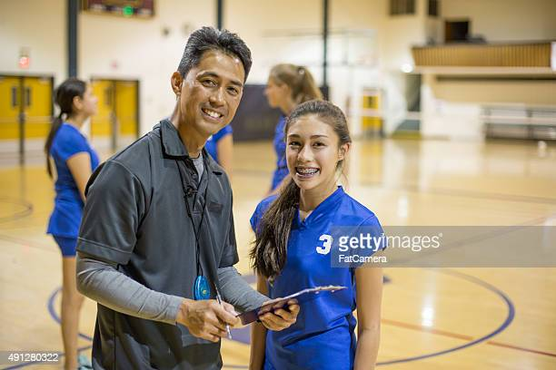 Girls volleyball player with coach