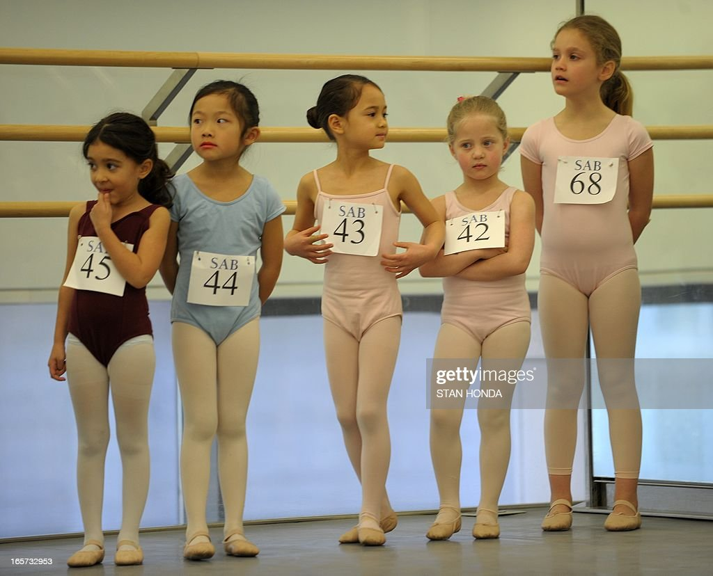 Girls wait as about 100 six-year-olds audition for spots in the School of American Ballet April 5, 2013 at Lincoln Center in New York.The audition is part of the spring recruiting season for new students. AFP PHOTO/Stan HONDA