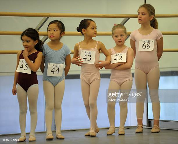 Girls wait as about 100 sixyearolds audition for spots in the School of American Ballet April 5 2013 at Lincoln Center in New YorkThe audition is...
