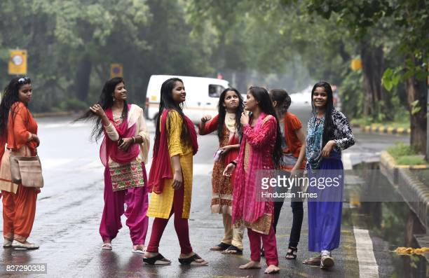 Girls waiting for a bus during heavy rain on the occasion of Raksha Bandhan on August 7 2017 in New Delhi India Raksha Bandhan or simply Rakhi is a...