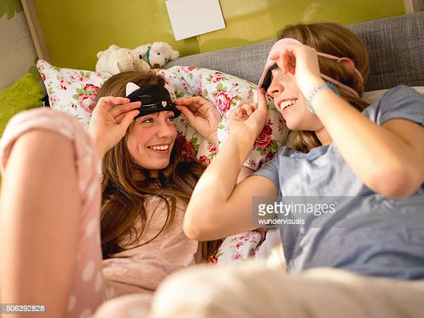 Girls waking up and looking from under cute sleeping masks