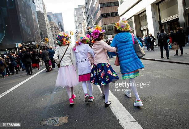 Girls walk during the Easter Parade and Bonnet Festival along 5th Avenue March 27 2016 in New York City The parade is a New York tradition dating...