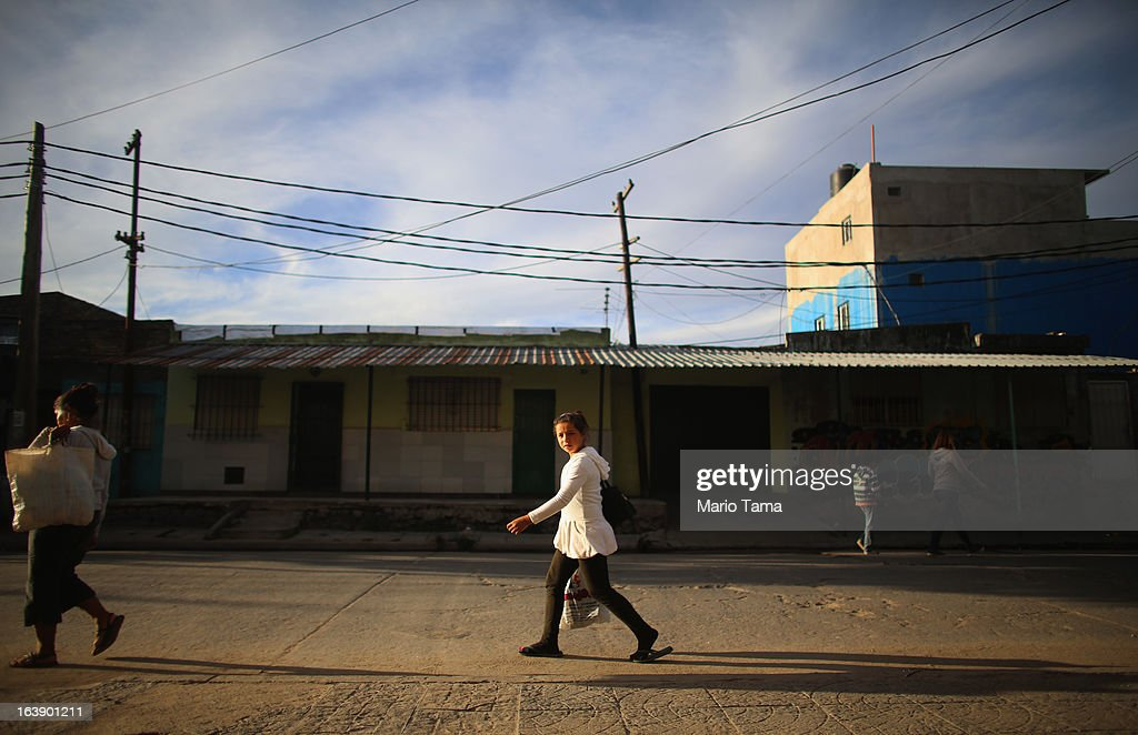A girls walks neart near the Virgin of the Miracles of Caacupe church following Sunday Mass in the Villa 21-24 slum, where archbishop Jorge Mario Bergoglio, now Pope Francis, used to perform charity work, on March 17, 2013 in Buenos Aires, Argentina. Francis was the archbishop of Buenos Aires and is the first Pope to hail from South America. Some locals are now affectionately calling Francis, known for his charity work in the slums, the 'slum pope.'