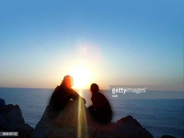 girls watching the sunrise
