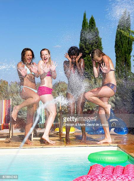 Girls watered on the side of the pool