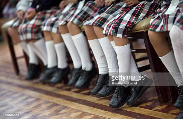 Girls wearing school uniforms