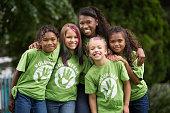 Girls wearing volunteer t-shirts outdoors