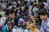 Girls wearing yukata watch the Generals' Meeting during the Soma Nomaoi festival in Minamisoma Fukushima Prefecture Japan on Saturday July 23 2016...