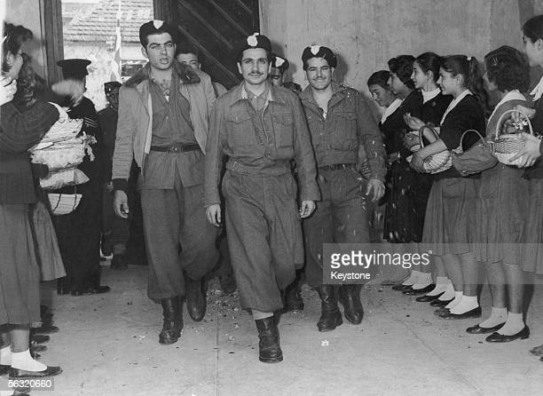 Girls welcoming EOKA soldiers to Nicosia with rose petals March 1959