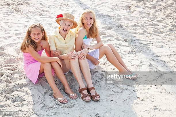 Girls with grandmother at the beach