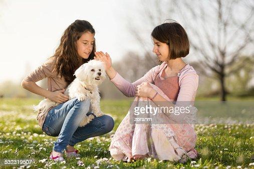 Girls with puppy