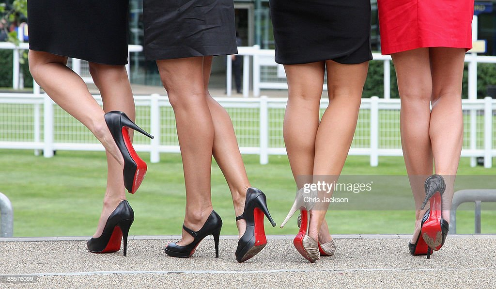 Girls with red soled high heeled shoes pose for a photograph on the second day of Royal Ascot 2009 at Ascot Racecourse on June 19 2009 in Ascot...
