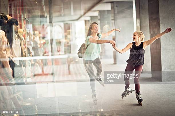 Girls with rollerskates having fun
