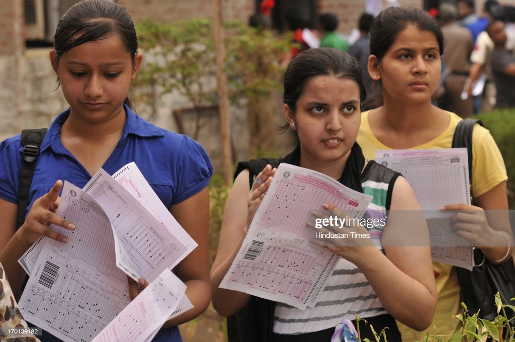 Girls with their forms for admission in four-year undergraduate programme at North Campus of Delhi University on June 7, 2013 in New Delhi, India.