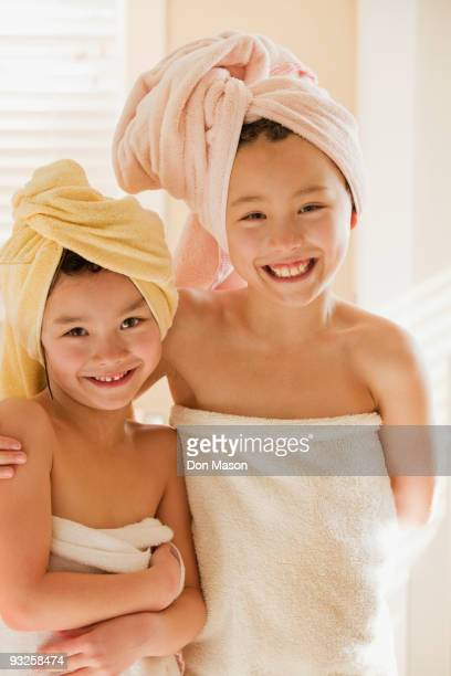 Girls wrapped in towels