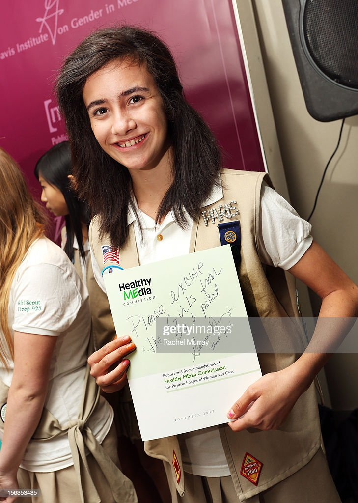 A girlscout displays her letter written by Geena Davis asking their teachers to excuse their absence from class this afternoon during the Geena Davis Institute On Gender In Media cocktail reception at SLS Hotel on November 13, 2012 in Beverly Hills, California.