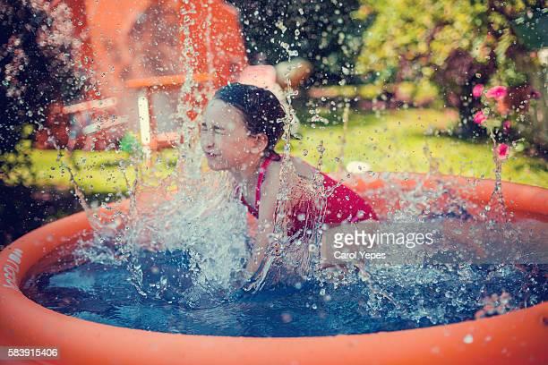 girlsplashing at poolside