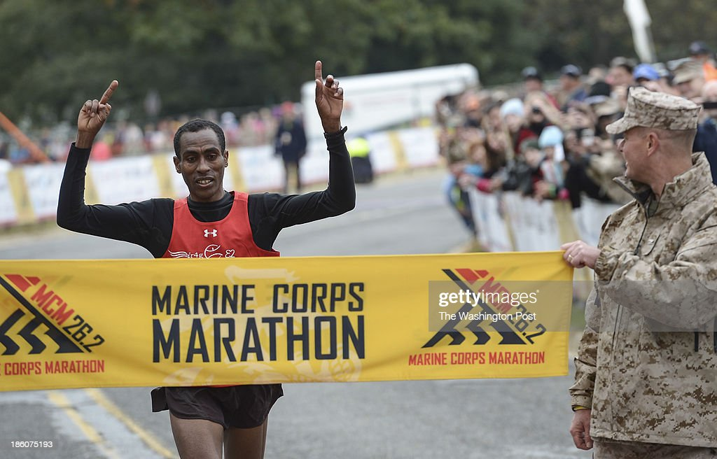 Girma Bedada crosses the finish line as the first male finisher during the 38th Marine Corps Marathon on Sunday, October 27, 2013. Bedada finished with a time of 2:21:32.