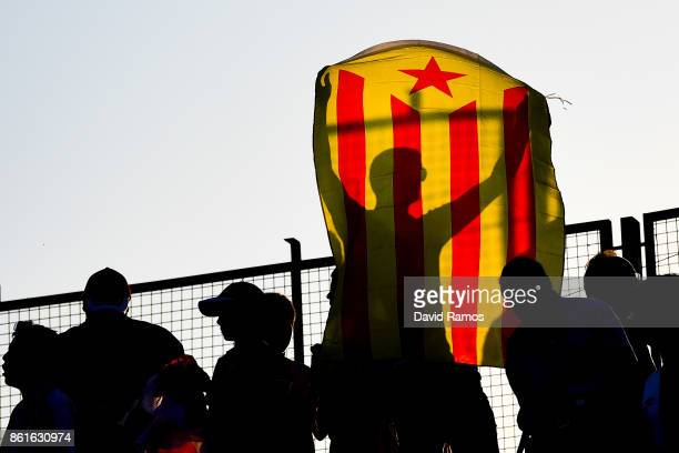 Girona CF supporter waves a Catalan ProIndependence flag known as 'Estelada during the La Liga match between Girona and Villarreal at Estadi de...