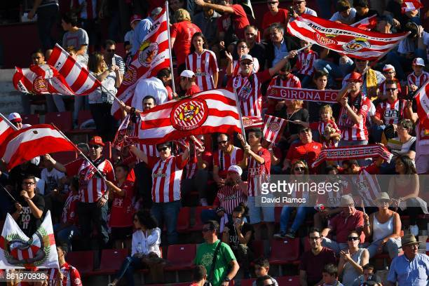 Girona CF supporters cheer on their team prior to the La Liga match between Girona and Villarreal at Estadi de Montilivi on October 15 2017 in Girona...