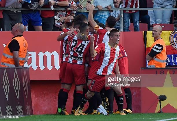 Girona's Spanish midfielder Pere Pons celebrates Girona's Uruguayan forward Christian Stuani's goal during the Spanish league football match Girona...