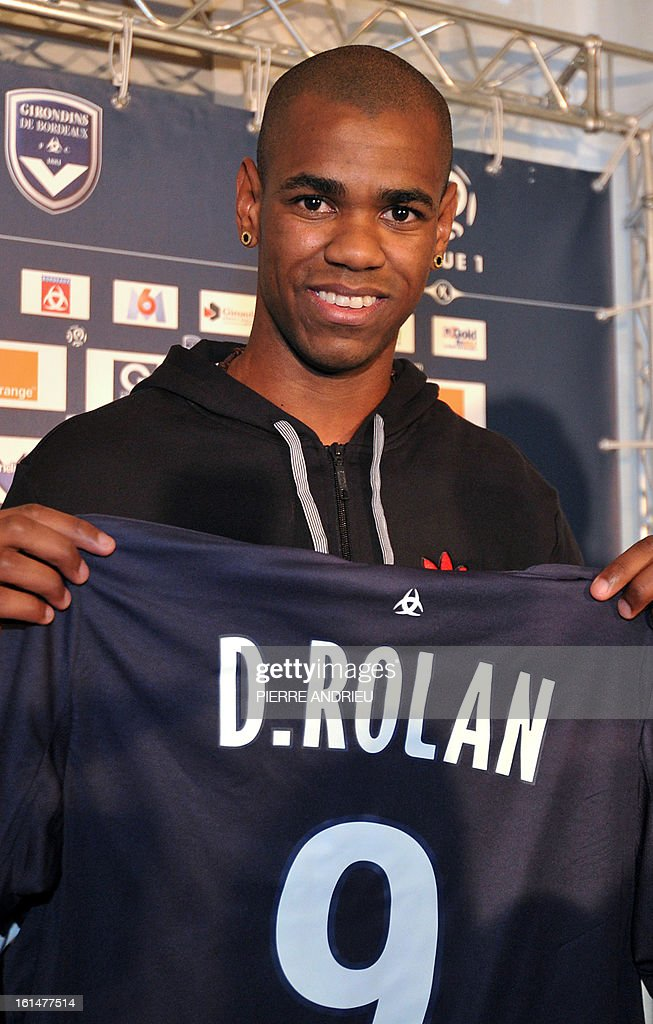 Girondins de Bordeaux L1 football club new forward Diego Rolan from Uruguay poses presenting his new jersey during a press conference on February 11, 2013 at le Haillan, outside Bordeaux. AFP PHOTO PIERRE ANDRIEU