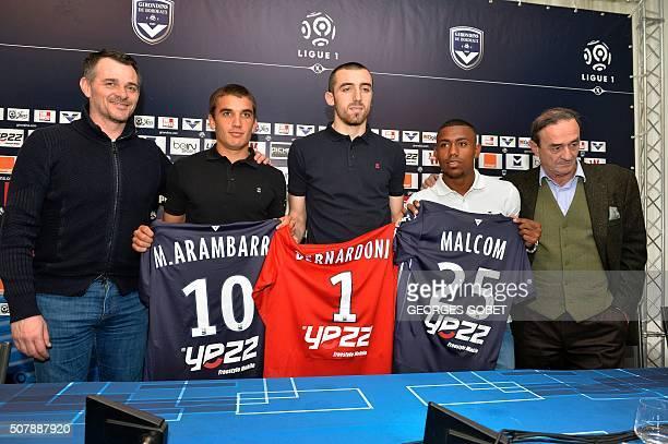 FC Girondins de Bordeaux's new Brazilian forward Malcom new goalkeeper Paul Bernardoni and Uruguayan midfielder Mauro Arambarri pose with Bordeaux's...